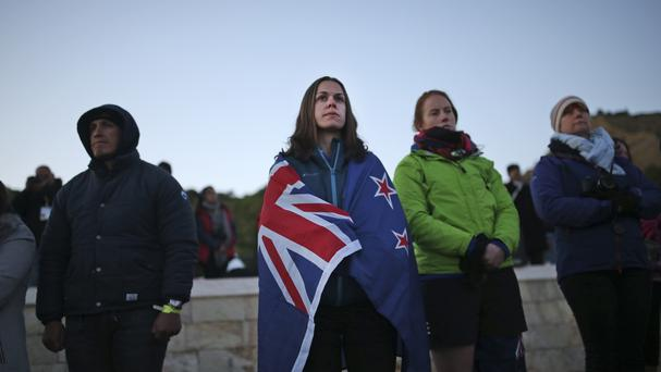 People watch the dawn service ceremony at the Anzac Cove beach in the Gallipoli peninsula, Turkey (AP/Emrah Gurel)