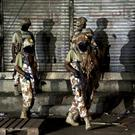 Pakistani paramilitary troops take up positions (AP/Shakil Adil)