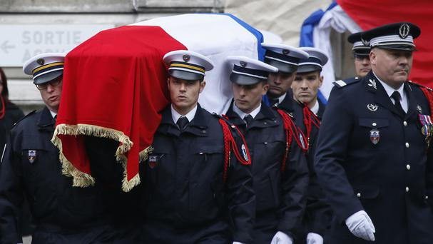The coffin of slain police officer Xavier Jugele is carried in the courtyard of the Paris Police headquarters (AP)
