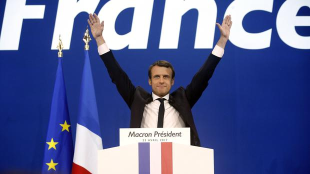 Mr Macron won the first round of voting and is in pole position to take the French presidency (AP)
