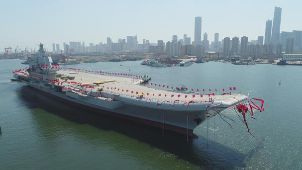 A newly-built aircraft carrier is transferred from dry dock into the water at a launch ceremony at a shipyard in Dalian. (Li Gang/Xinhua/AP)