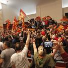 Protesters shout after storming the Macedonian parliament in Skopje (Boris Grdanoski/AP)