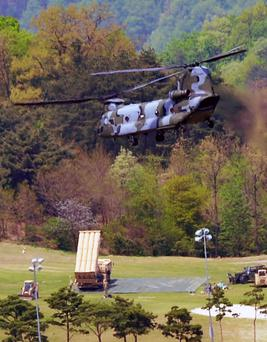 A Terminal High Altitude Area Defence (THAAD) interceptor is seen in Seongju, South Korea, this week as a helicopter takes off. Photo: Reuters