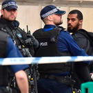 Armed police detain a man at the scene following an incident in Whitehall, London, yesterday. Photo: PA