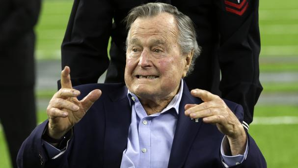 George HW Bush, pictured in February, has been discharged from hospital (Eric Gay/AP)
