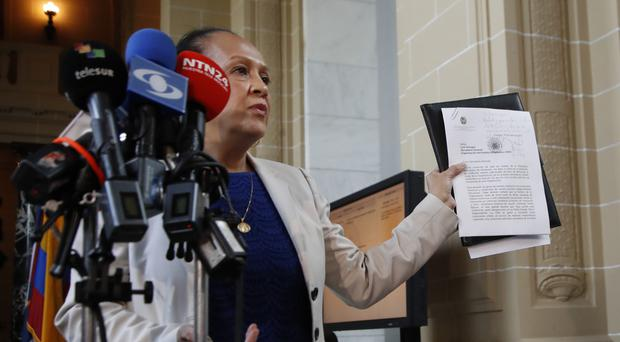 Venezuelan ambassador to the Organisation of American States Carmen Velasquez delivers a formal letter notifying her country's intention to withdraw from the OAS (AP)