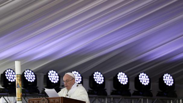 Pope Francis celebrates Mass for Egypt's tiny Catholic community, at the Air Defence Stadium in Cairo (AP)
