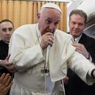 Pope Francis talks during a press conference he held on his return flight from Cairo to Rome (AP)