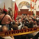 Protesters enter the parliament building in Skopje, Macedonia (AP)