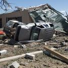 A storm spotter inspects the damage after a tornado hit Canton, Texas (Tom Fox/The Dallas Morning News via AP)