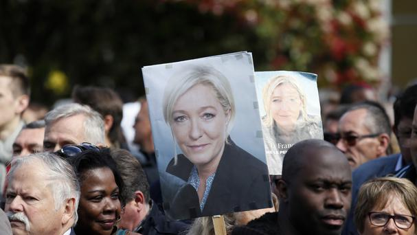 Supporters of far-right presidential candidate Marine Le Pen arrive at a campaign meeting (AP)