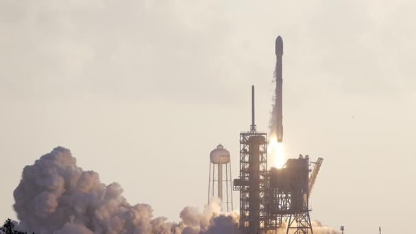 A Falcon 9 SpaceX rocket carrying a classified satellite for the National Reconnaissance Office lifts off from pad 39A at the Kennedy Space Centre in Cape Canaveral (AP)