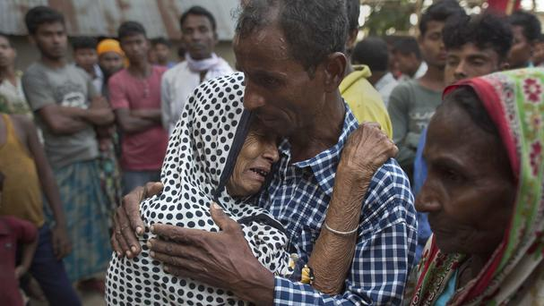 Shar Banu, 65, grandmother of Reaz Uddin, 18, who was beaten to death by a mob on Sunday night, cries outside her home in Naramari village (AP)
