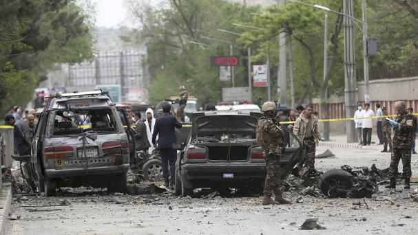 Security forces inspect the site of a suicide attack in Kabul. (AP/Massoud Hossaini)