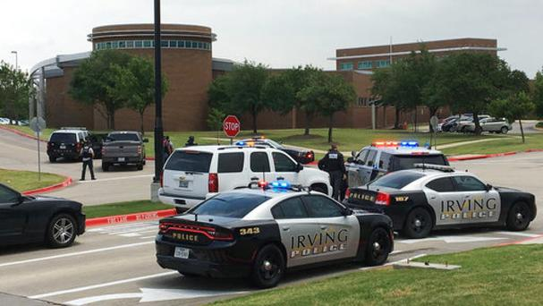 Police officers at the North Lake College campus in Irving, Texas (Jae S Lee/The Dallas Morning News via AP)