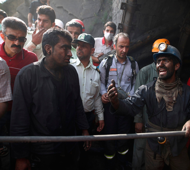 Coal miners and rescue workers gather at the scene following an explosion in a coal mine in Azadshahr, in northern Iran, which left dozens of miners trapped. Photo: Hassan Zadeh/Getty
