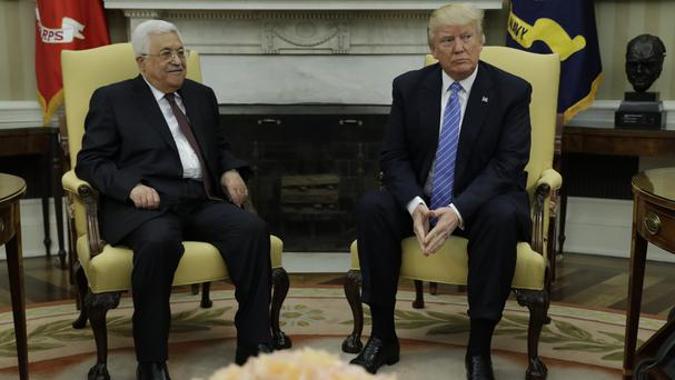 Donald Trump, right, meets Palestinian leader Mahmoud Abbas in the Oval Office (AP)