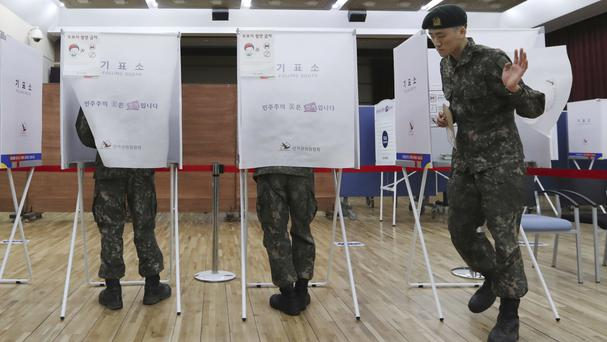 A South Korean soldier exits a polling booth in Seoul after casting his early vote for the May 9 presidential election (AP/Lee Jin-man)