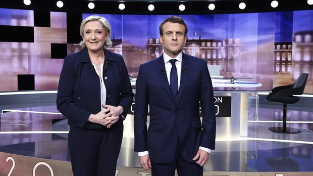 French presidential election candidates Marine Le Pen and Emmanuel Macron before the debate (Eric Feferberg/Pool Photo via AP)