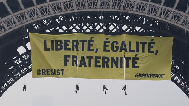 Greenpeace unfurls anti-Le Pen 'resist' banner on Eiffel Tower