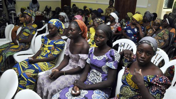 Chibok schoolgirls freed from Boko Haram have arrived in Abuja (AP)