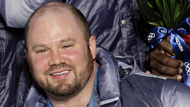 Steven Holcomb pictured after the US four-man bobsled victory at the Vancouver 2010 Olympics (AP)