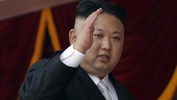 North Korean leader Kim Jong Un waves during a parade (AP)