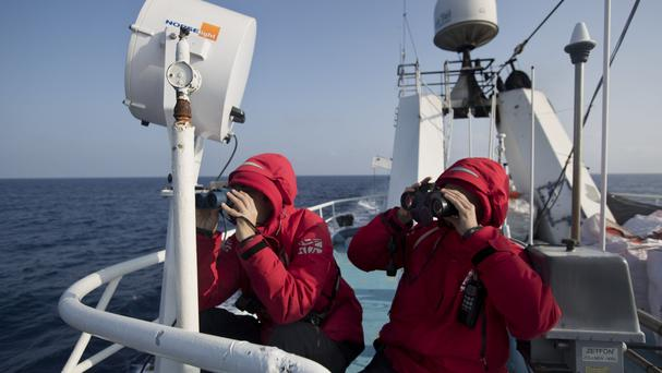A crew conducts a search and rescue operation in the Mediterranean sea (AP)