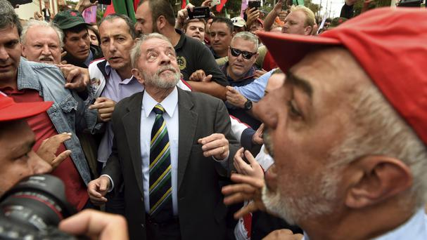 Luiz Inacio Lula da Silva is greeted by supporters as he arrives at the Federal Justice building in Curitiba, Brazil (Denis Ferreira Netto/AP)