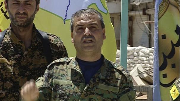 An SDF commander identified only as Abdelqader makes a statement after the force captured Tabqa from Islamic State, in Tabqa town, north Syria (SDF via AP)