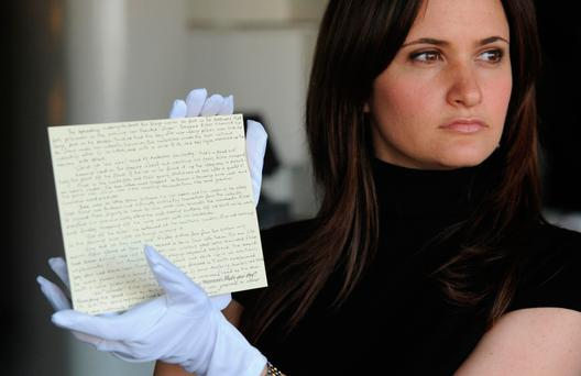 A file picture from 2008 shows an auction house worker with the now-stolen manuscript