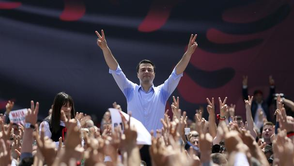 Lulzim Basha, leader of Albania's main opposition Democratic Party, gestures to his supporters (Hektor Pustina/AP)