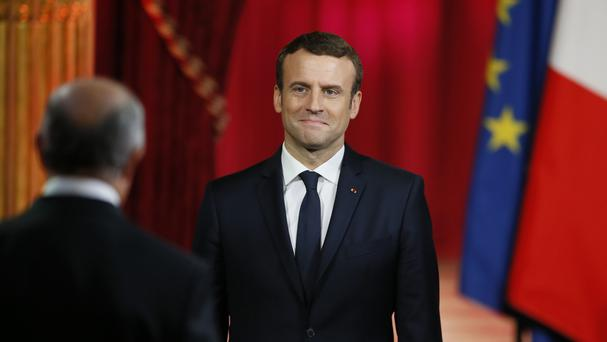 France's Emmanuel Macron signals modest approach with 450 euro inauguration suit