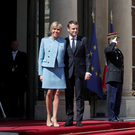 Emmanuel Macron and his wife Brigitte on the steps of the Élysée Palace Photo: REUTERS/Benoit Tessier