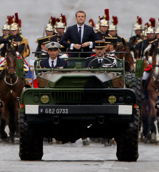 Mr Macron is driven in a military vehicle on the Champs Élysées