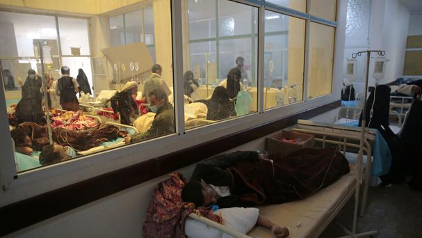 People are treated for suspected cholera infection at a hospital in Sanaa, Yemen.. (AP/Hani Mohammed)