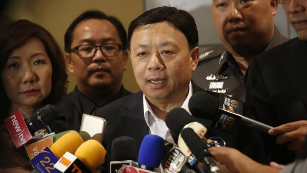 Thailand's broadcasting and telecommunication chief Takorn Tantasith talks to reporters in Bangkok (AP)