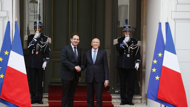 Newly named French Interior Minister Gerard Collomb, right, shakes hands with outgoing Interior Minister Matthias Fekl. (AP/Francois Mori)