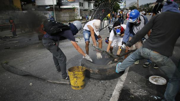 Demonstrators during a national sit-in against President Nicolas Maduro, in Caracas, Venezuela (AP)