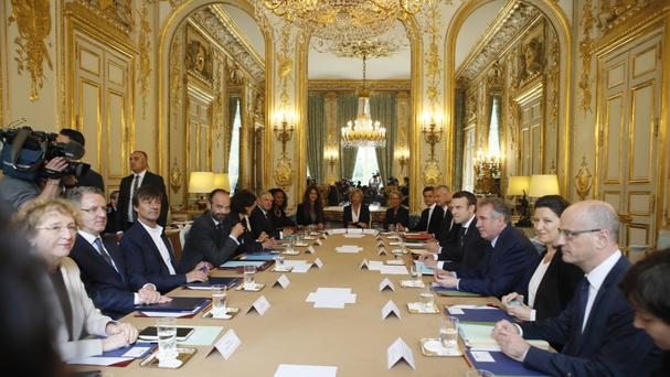 French president Emmanuel Macron gathers his Cabinet for its first meeting at the Elysee Palace (AP)
