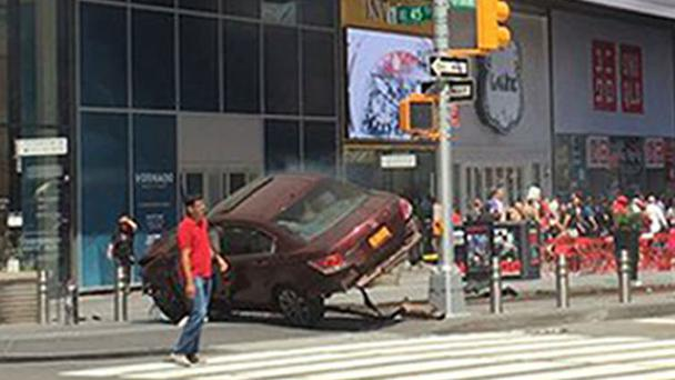 The scene in Times Square after an out-of-control car crashed (@Bad_Episode/PA Wire)