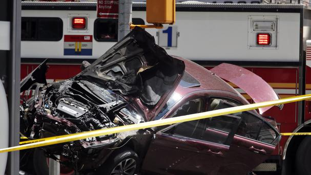 The smashed car sits on the corner of Broadway and 45th Street in New York's Times Square (AP)