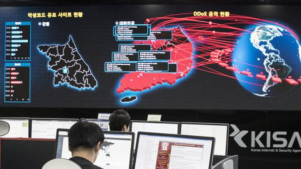 Workers watch electronic boards to monitor possible ransomware cyber attacks at the Korea Internet and Security Agency in Seoul, South Korea (AP)
