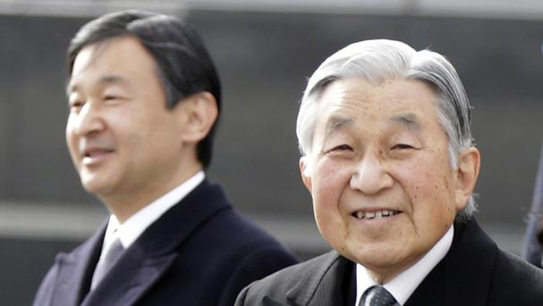 Emperor Akihito, right, with Crown Prince Naruhito (AP)