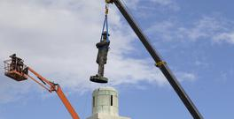 A statue of Confederate General Robert E Lee is removed from Lee Circle in New Orleans (AP)