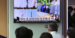 People watch a TV news programme showing images of North Korean leader Kim Jong Un and the missile launch, published in the North Korea's Rodong Sinmun newspaper, at Seoul Railway station in Seoul, South Korea (AP)