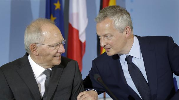German finance minister Wolfgang Schaeuble and Bruno Le Maire France's economy minister address the media in Berlin