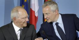 German finance minister Wolfgang Schaeuble and Bruno Le Maire, France's economy minister, address the media in Berlin (AP)