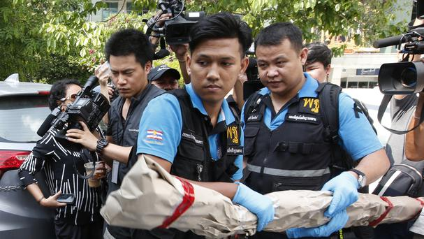 Thai forensic officers remove evidence from Phramongkutklao Hospital in Bangkok after a bomb blast (AP Photo/Sakchai Lalit)