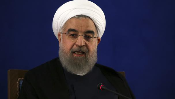 Mr Rouhani secured a second term in office last week (AP)